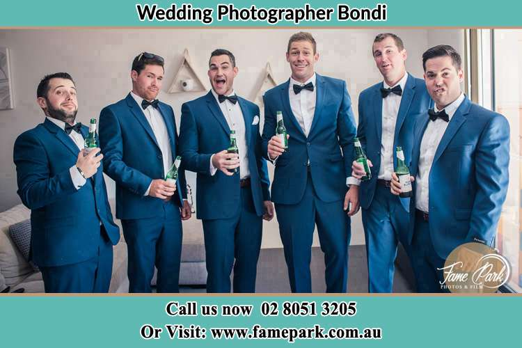 The groom and his groomsmen striking a wacky pose in front of the camera Bondi NSW 2026