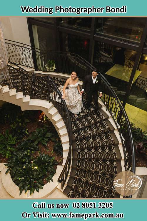 Photo of the Bride and the Groom going down the stair Bondi NSW 2026