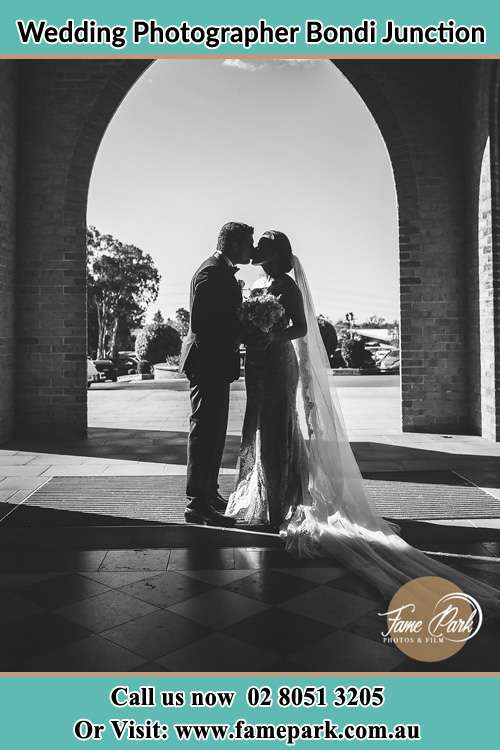 Photo of the Groom and the Bride kissing at the front of the church Bondi Junction NSW 2022