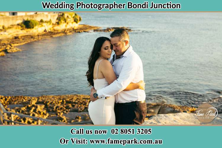 Photo of the Bride and the Groom hugging near the lake Bondi Junction NSW 2022