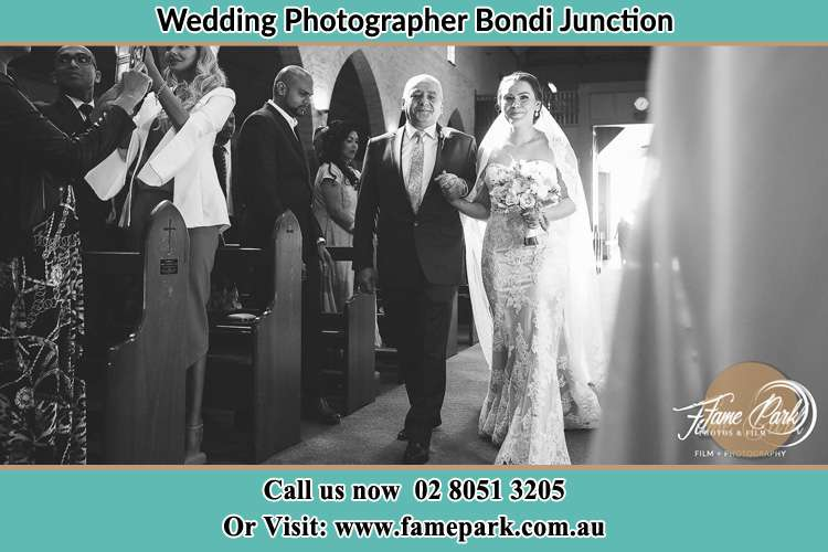 Photo of the Bride and her father walking the aisle Bondi Junction NSW 2022