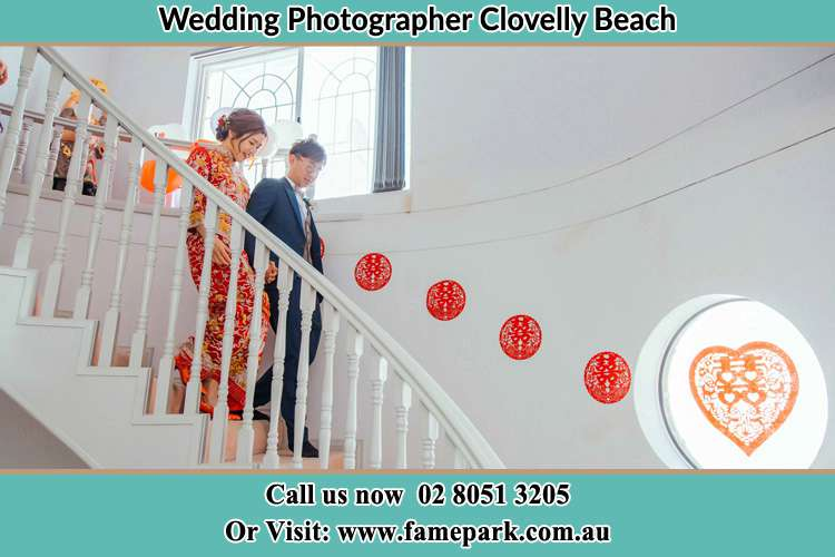 Photo of the Bride and the Groom going down the stair Clovelly Beach NSW 2031