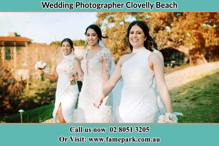 Photo of the Bride and the bridesmaids walking Clovelly Beach NSW 2031