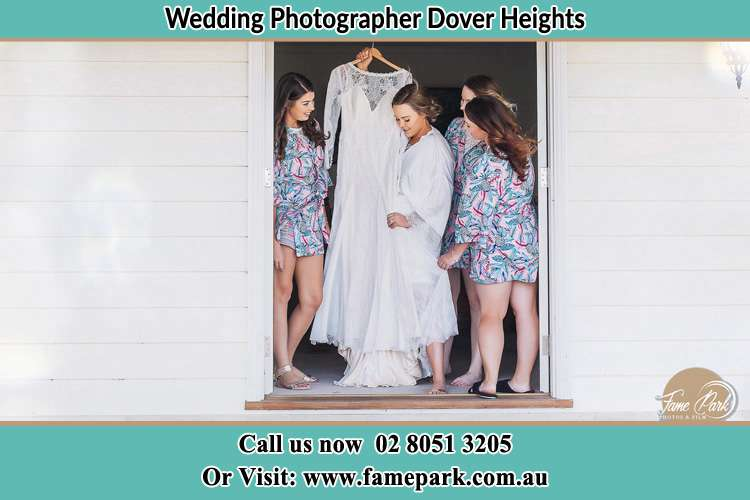 Photo of the Bride and the bridesmaids checking the wedding gown at the door Dover Heights NSW 2030