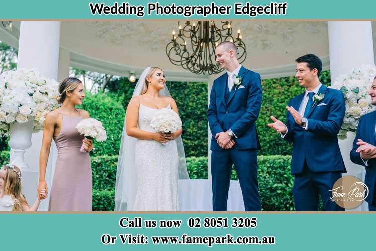 Photo of the Bride and the Groom happily looking each other with the entourage Edgecliff NSW 2027