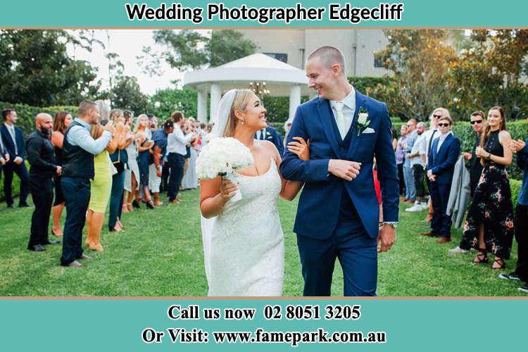 Photo of the Bride and the Groom looking each other while walking Edgecliff NSW 2027