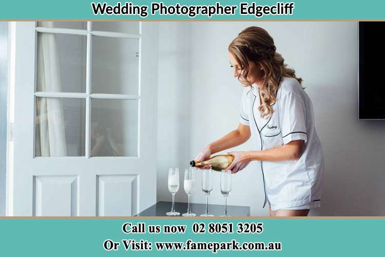 Photo of the Bride pouring wine to the glasses Edgecliff NSW 2027