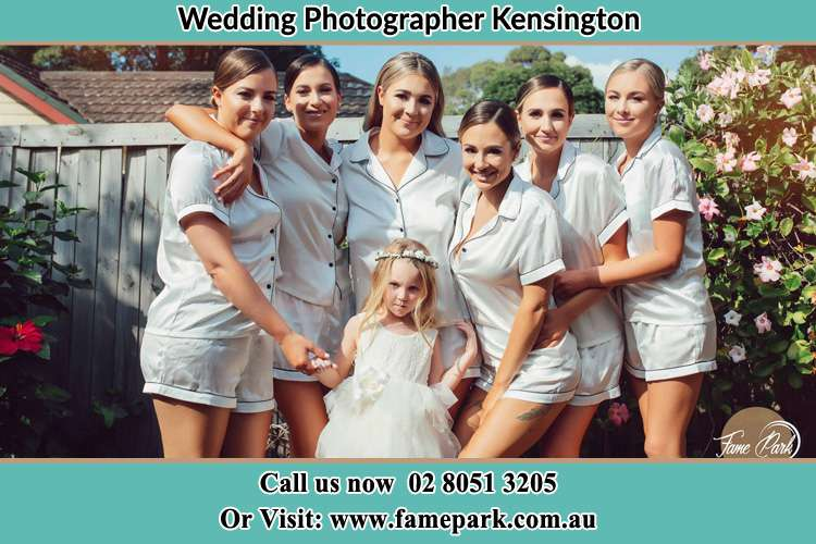 The Bride and the bridesmaids with the flower girl striking a pose on camera Kensington NSW 2033