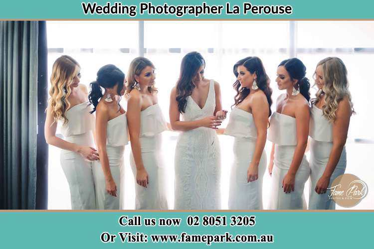 Photo of the Bride and the bridesmaids looking at her La Perouse NSW 2036