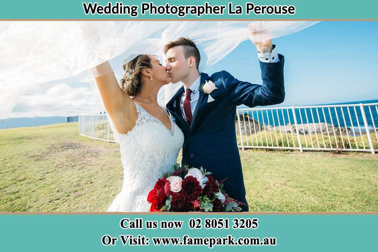 Photo of the Bride and the Groom kissing at the yard La Perouse NSW 2036