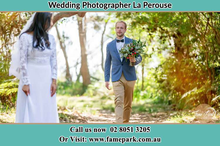 Photo of the Groom bringing flower to the Bride La Perouse NSW 2036