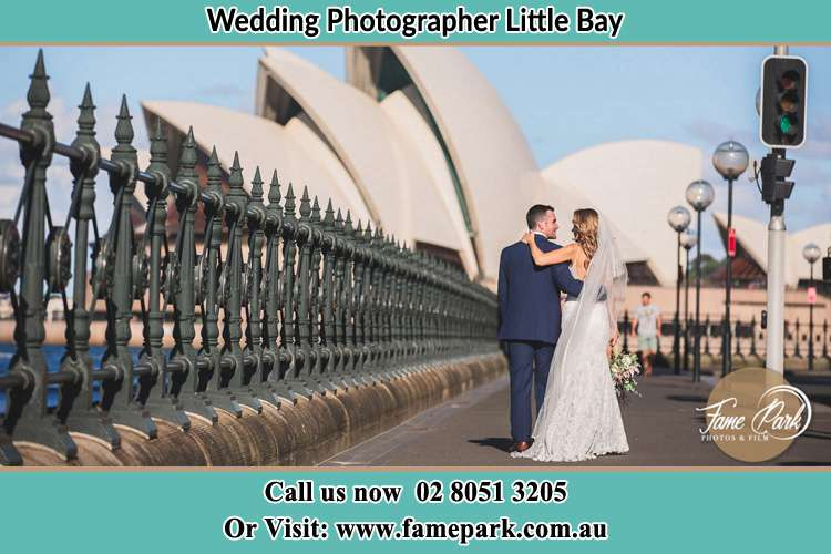 The Groom and the Bride walking towards the Sydney Grand Opera House Little Bay NSW 2036