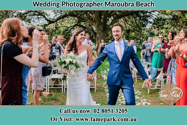 Photo of the Bride and the Groom showering bubbles by the visitors Maroubra Beach NSW 2035