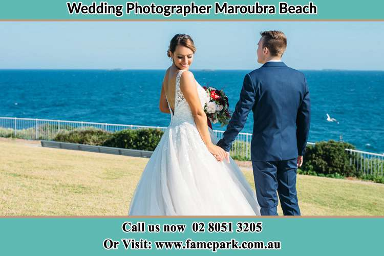 Photo of the Bride and the Groom holding hands on the yard Maroubra Beach NSW 2035
