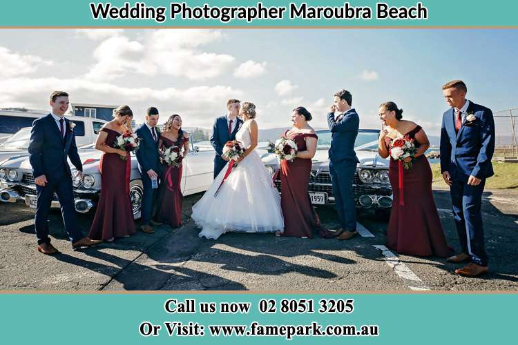 Photo of the Groom and the Bride with the entourage at the parking lot Maroubra Beach NSW 2035