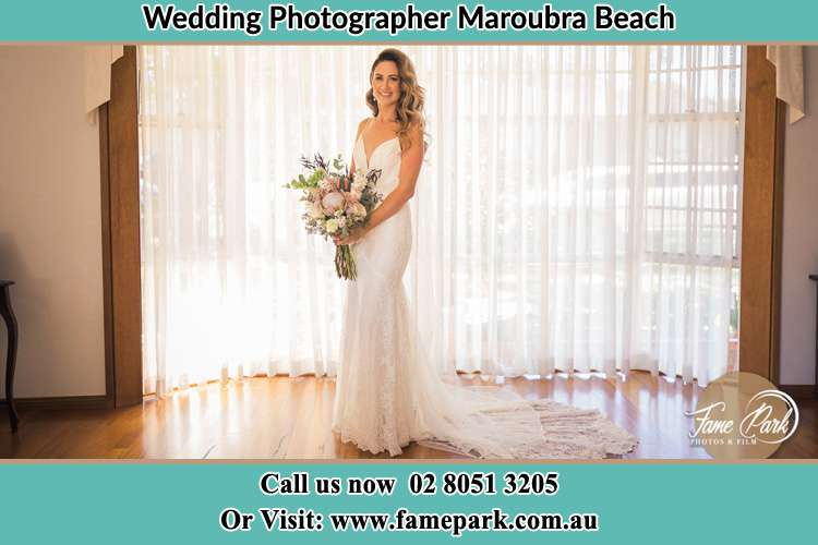 Photo of the Bride holding flower of bouquet Maroubra Beach NSW 2035
