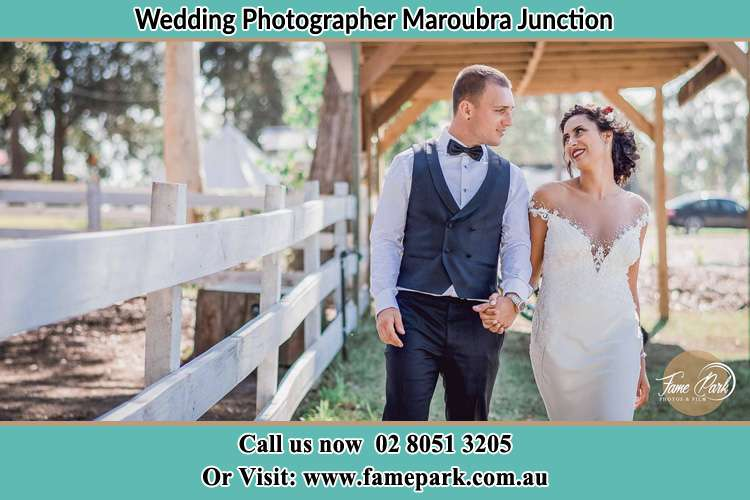 Photo of the Groom and the Bride looking each other while walking Maroubra Junction NSW 2035