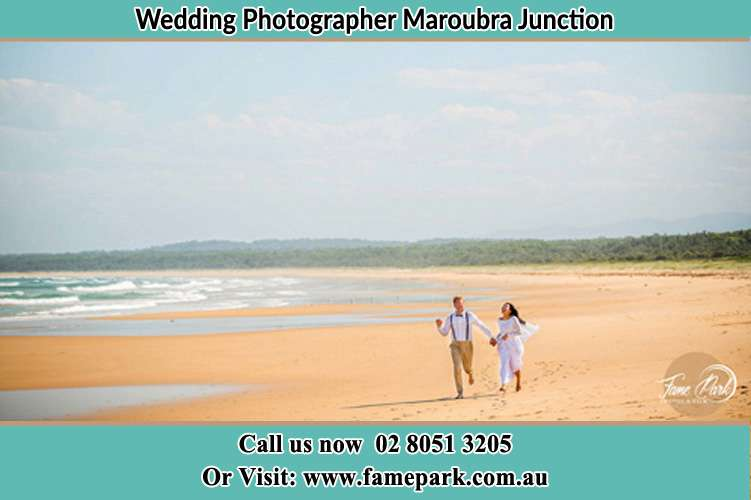 Photo of the Groom and the Bride walking at the sea shore Maroubra Junction NSW 2035