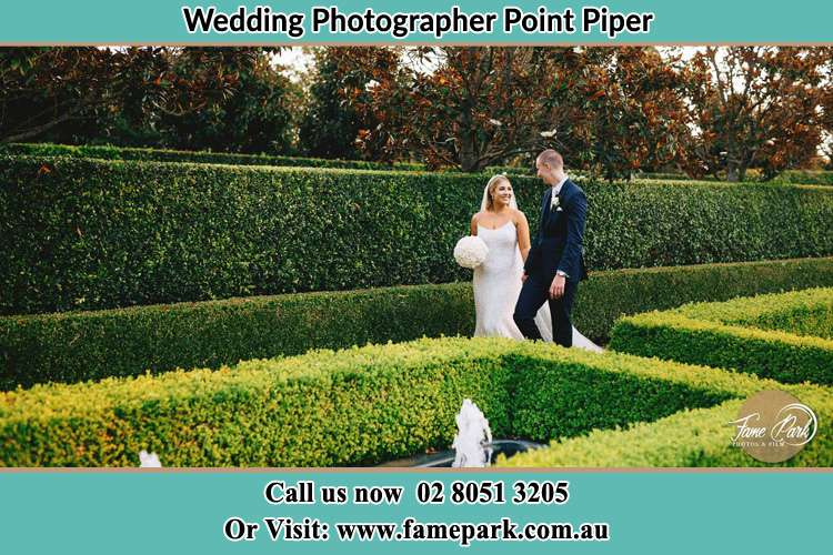 Photo of the Bride and the Groom walking at the garden Point Piper NSW 2027