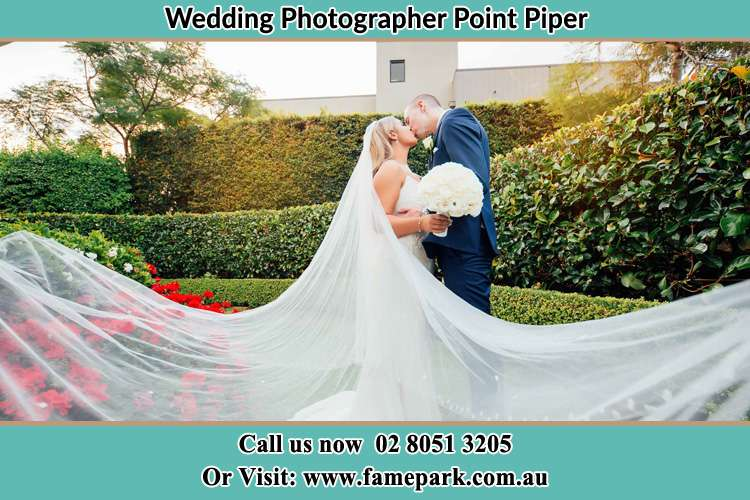 Photo of the Bride and the Groom kissing at the garden Point Piper NSW 2027