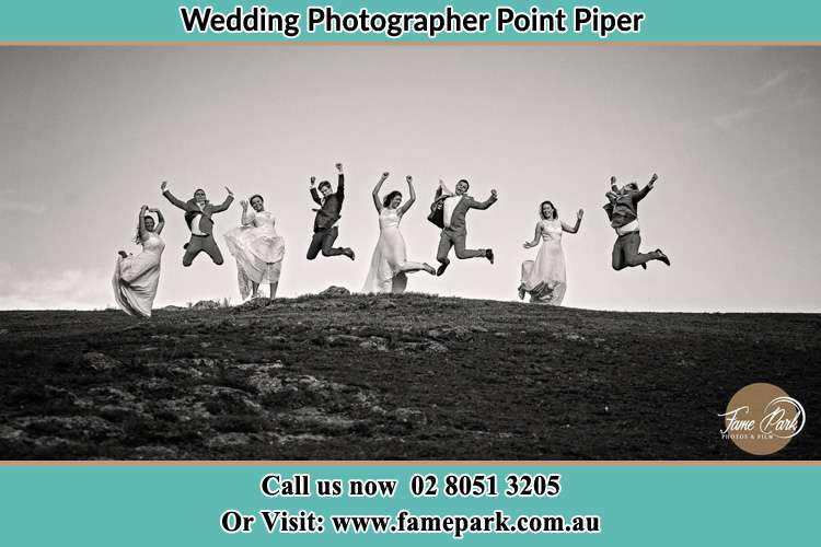 Jump shot photo of the Bride and the Groom and the secondary sponsors Point Piper NSW 2027