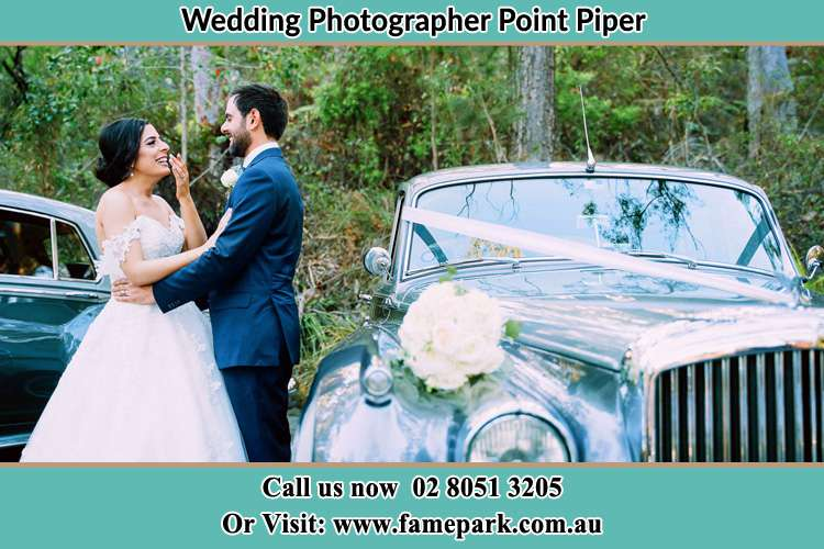 Photo of the Bride and the Groom besides the bridal car Point Piper NSW 2027