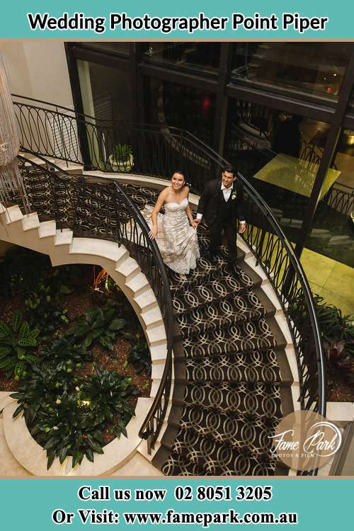 Photo of the Bride and the Groom walking down the stair Point Piper NSW 2027