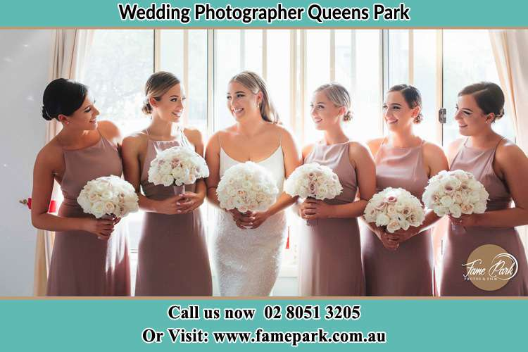 Photo of the Bride and the bridesmaids holding flower bouquet Queens Park NSW 2022