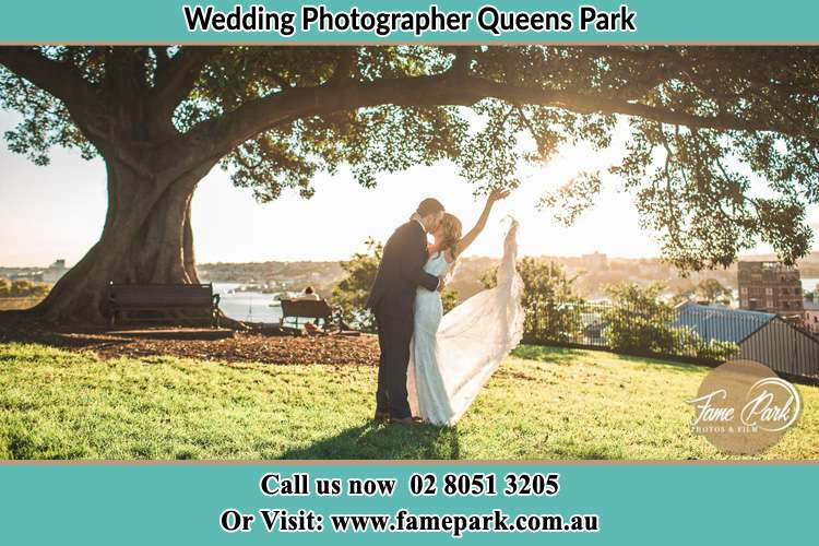 Photo of the Bride and the Groom dancing under the tree Queens Park NSW 2022