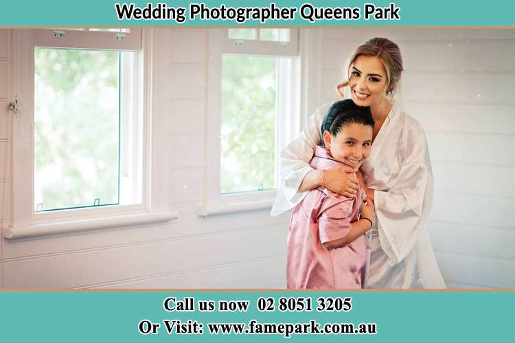 Photo of the Bride hugging the flower girl Queens Park NSW 2022