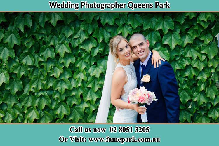 The Bride and the Groom smiling at the camera Queens Park NSW 2022