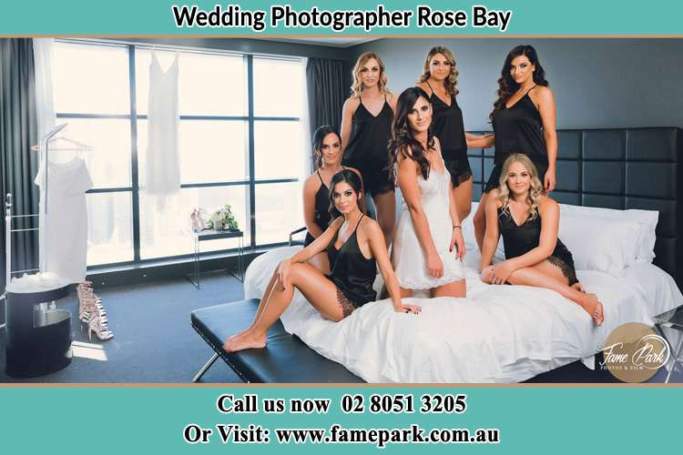 Photo of the Bride and the bridesmaids wearing lingerie on the bed Rose Bay NSW 2029