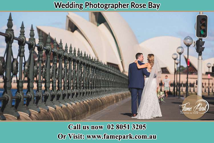 The Groom and the Bride walking towards the Sydney Grand Opera House Rose Bay NSW 2029