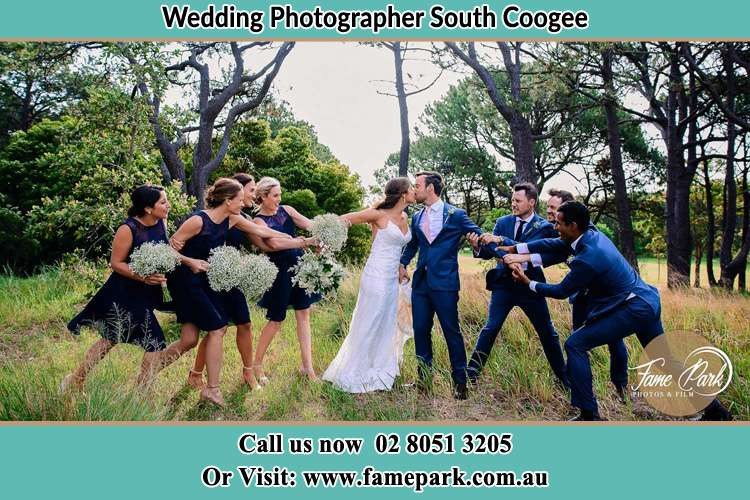 Photo of the Bride and the Groom kissing teasing by the secondary sponsors South Coogee NSW 2034