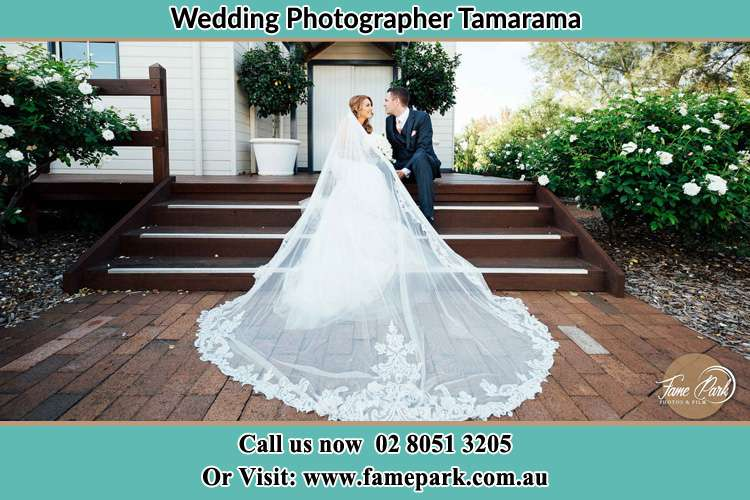 Photo of the Bride and the Groom looking each other while sitting at the staircase Tamarama NSW 2026