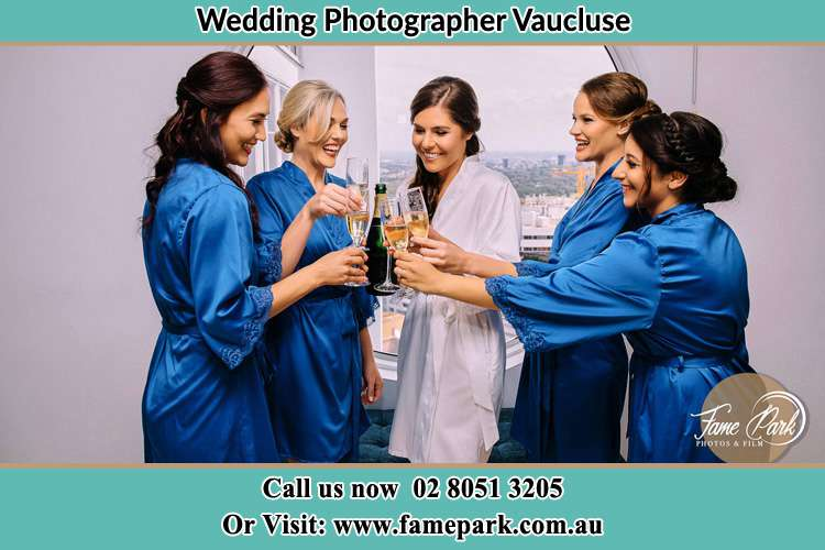 Photo of the Bride and the bridesmaid having wine Vaucluse NSW 2030