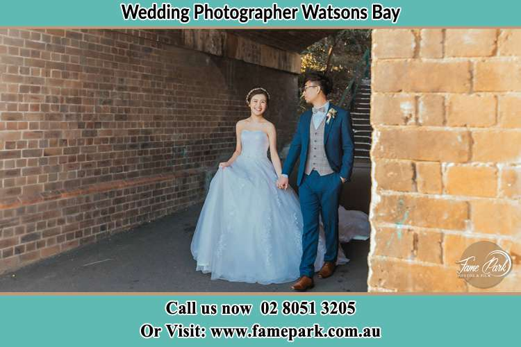 Photo of the Bride and the Groom holding hands while walking Watsons Bay NSW 2030