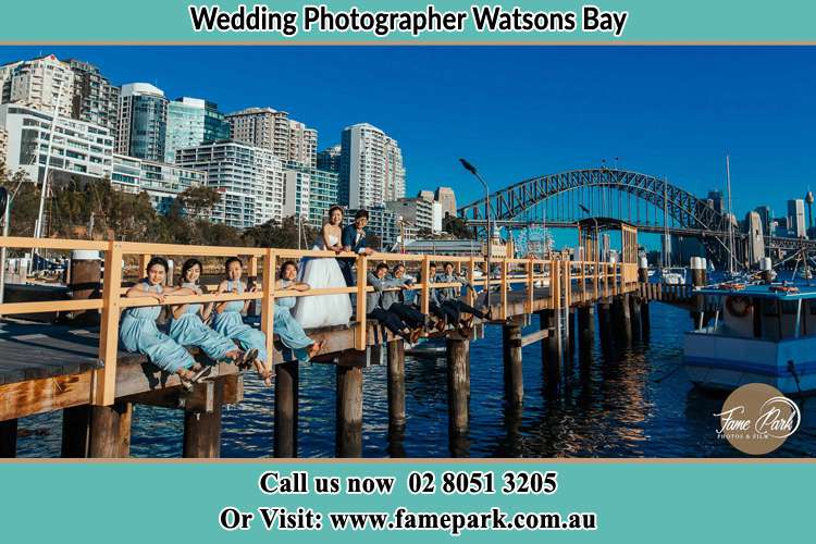 Photo of the Bride and the Groom with the entourage at the bridge Watsons Bay NSW 2030