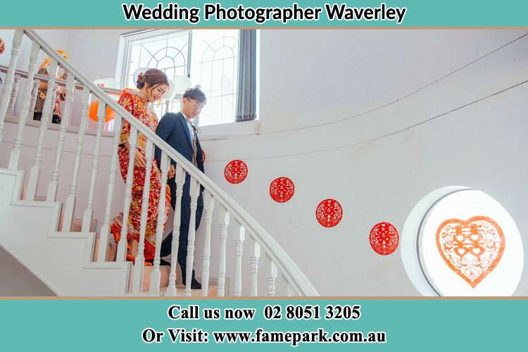 Photo of the Bride and the Groom going down the stair Waverley NSW 2024